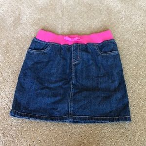 Denim skirt with pink elastic.